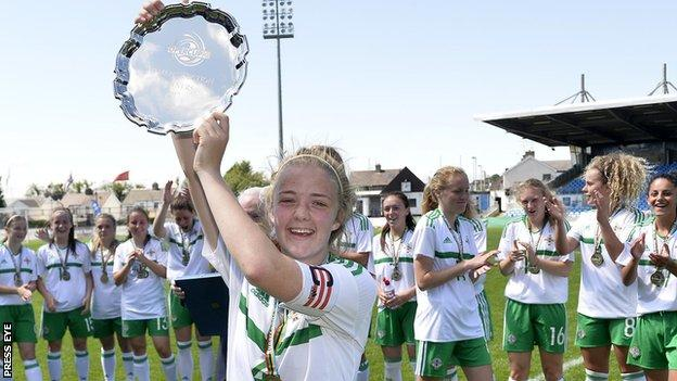 Emma McMaster lifts the silverware after the double success over Wales at the Super Cup NI
