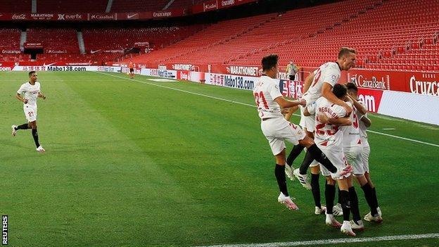 Sevilla celebrate their second goal