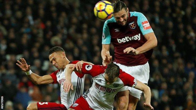 West Ham striker Andy Carroll scores against West Brom