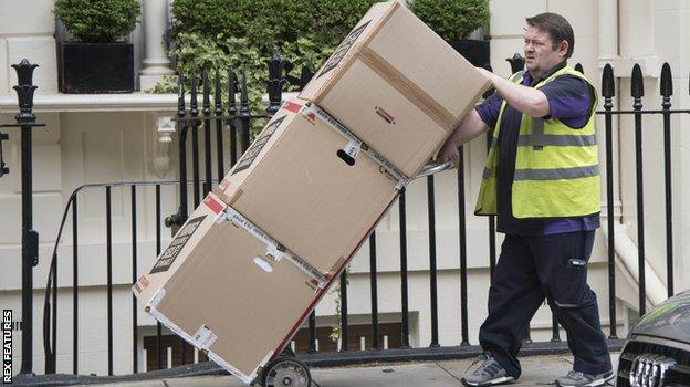 Removal men were seen at Mourinho's London home on Monday