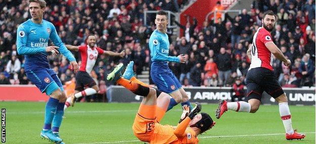 Charlie Austin scores the opener against Arsenal