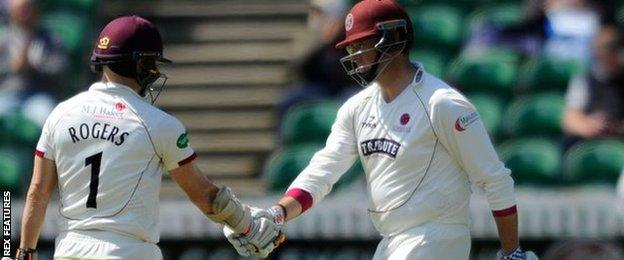 Marcus Trescothick celebrates his half century against Yorkshire at Taunton with Somerset captain Chris Rogers