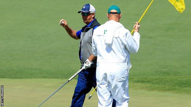 Sandy Lyle salutes the crowd after making a birdie at the second hole