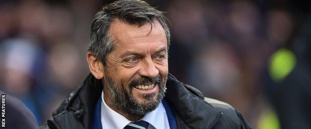 Phil Brown smiles on the sidelines