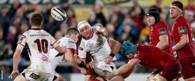 Ulster captain Rory Best passes to Billy Burns
