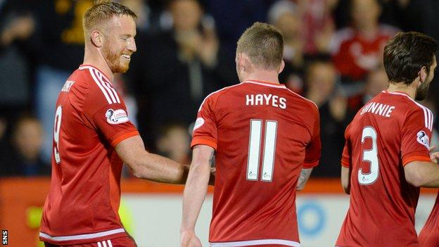 Adam Rooney (left) put Aberdeen in front from the penalty spot