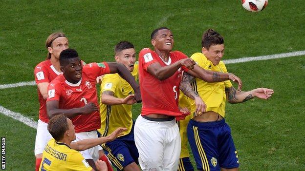 Switzerland battle against Sweden in the World Cup last-16 match