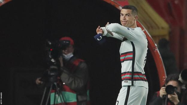 Ronaldo peels off the captain's armband before tossing it to the ground