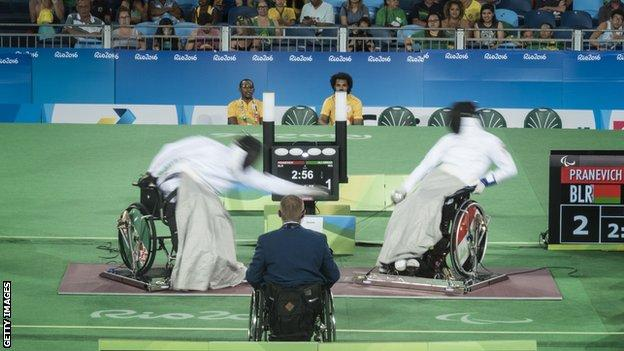 Andrei Pranevich of Belarus battles Ammar Ali of Iraq in the final of Wheelchair Fencing Men's Category B at the Rio Paralympic Games