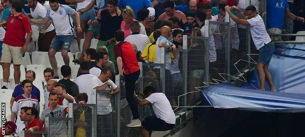 England fans jump barriers to get to safety in the match against Russia