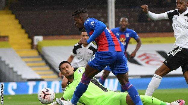 Crystal Palace's Wilfried Zaha has a shot in their Premier League game against Fulham