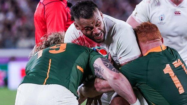 England's powerful number eight Billy Vunipola tries to break a tackle against South Africa in the 2019 World Cup final