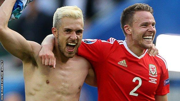 Aaron Ramsey (left) celebrates Wales' opening Euro 2016 win against Slovakia with Chris Gunter