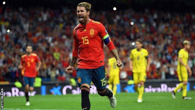 Sergio Ramos celebrates scoring a penalty against Sweden