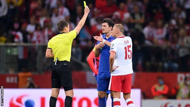 England's Harry Maguire and Poland's Kamil Glik were booked before half time