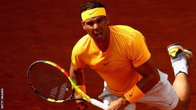 Rafael Nadal serves at the 2019 Madrid Open