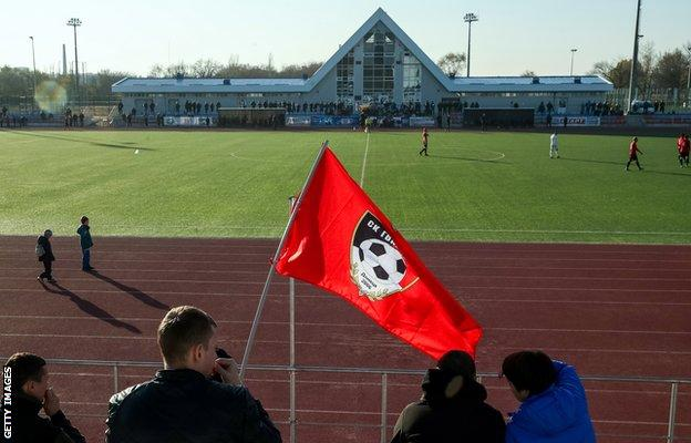 Fans at the 2018 Donbass Cup Winners' Cup final between Gvardeets and Dalevets from the Donetsk and Lugansk People's Republics respectively at the Kirovets Sports Club in Donetsk