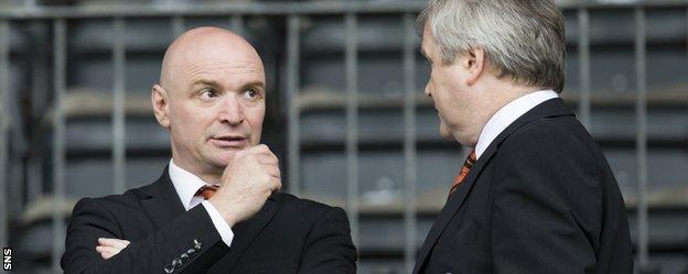 Dundee United chairman Stephen Thompson (left) looks concerned at McDiarmid Park