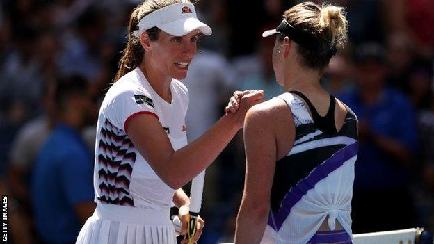 Johanna Konta shakes hands with Elina Svitolina at the net