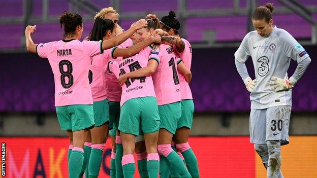 Barcelona celebrate while Ann Katrin-Berger looks dejected