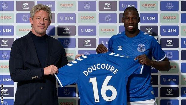 Everton's director of football Marcel Brands with new signing Abdoulaye Doucoure