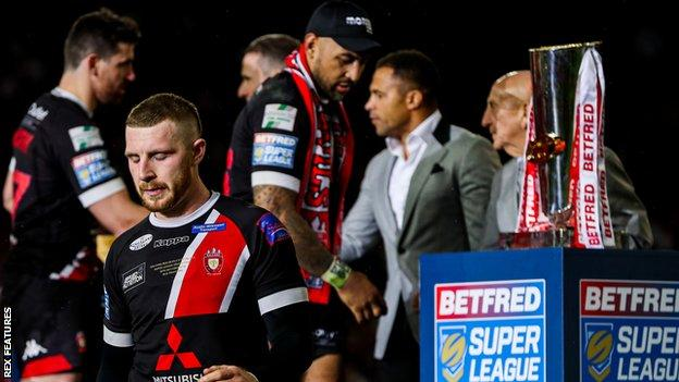 Dejected Salford players