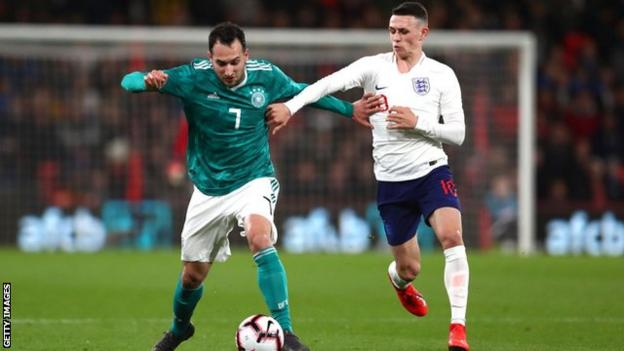 Phil Foden battling for the ball