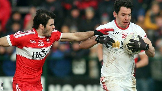 Derry defender Karl McKaigue challenges Tyrone's Mattie Donnelly in the McKenna Cup clash