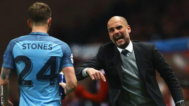 Man City defender John Stones and manager Pep Guardiola