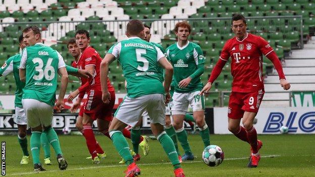 Robert Lewandowski (right) scores