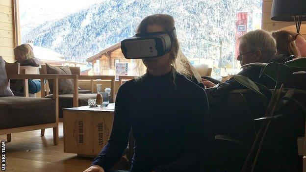 Laurenne sitting down is from our team hotel in St Mortiz at the 2017 World Ski Championship she's watching the Downhill course the afternoon before the race (she finished 5th). She is using a Samsung phone and HMD.