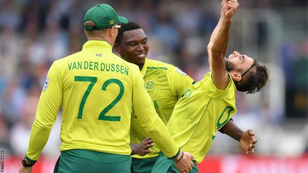 Rassie van der Dussen, Lungi Ngidi (centre) and Imran Tahir celebrate a wicket for South Africa