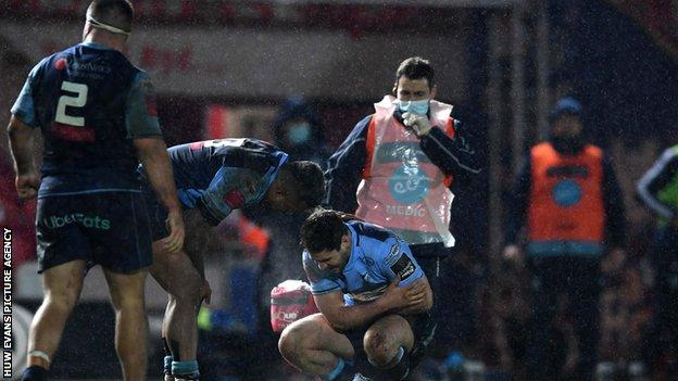 Cardiff Blues scrum-half Tomos Williams in discomfort after suffering injury against Scarlets