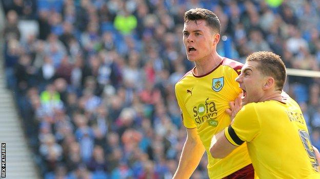 Burnley's Michael Keane (left) is congratulated by Sam Vokes