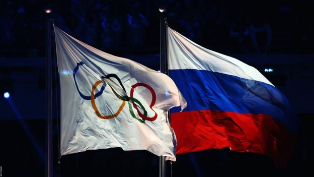 Olympic flag and Russia flag