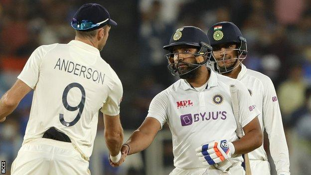 James Anderson shakes hands with Rohit Sharma