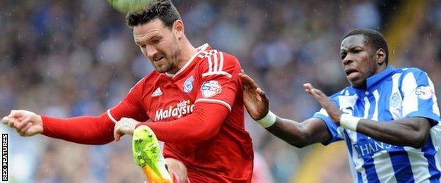 Cardiff's Sean Morrison (left) challenges Lucas Joao of Sheffield Wednesday