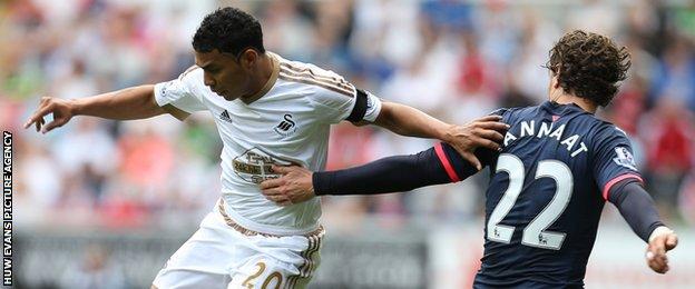 Newcastle's Daryl Janmaat (right) fouls Jefferson Montero of Swansea