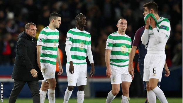 Celtic manager Brendan Rodgers on the pitch with his players after the final whistle.