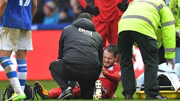 Birmingham's Jonathan Grounds on the ground injured