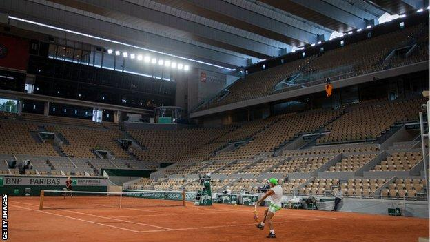 Rafael Nadal plays under the Court Philippe Chatrier floodlights at the 2020 French Open