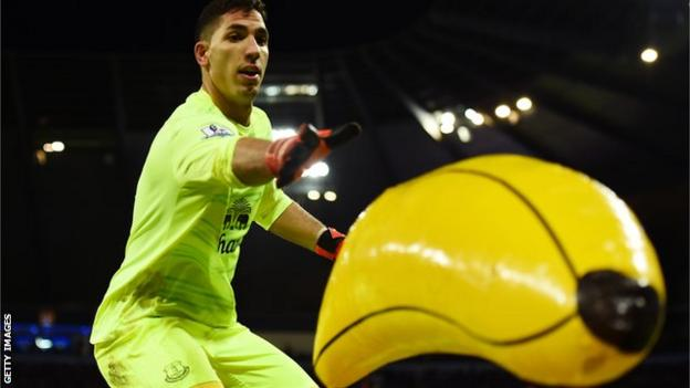 Everton keeper Joel Robles removes an inflatable banana from the pitch during the League Cup semi-final against Manchester City at the Etihad Stadium in 2016