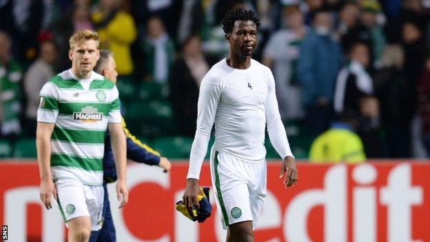 Celtic defender Efe Ambrose walks off after drawing in in their Europa league match against Fenerbahce 2-2.