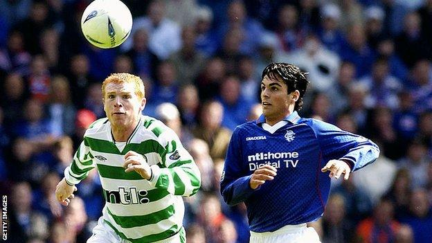 Arteta (right) challenges Neil Lennon for the ball