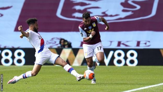 Aston Villa's Trezeguet takes on Crystal Palace's Andros Townsend