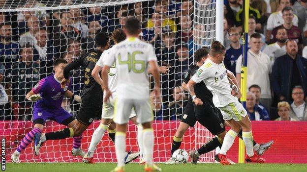 Leeds' Kalvin Phillips scores against Crewe