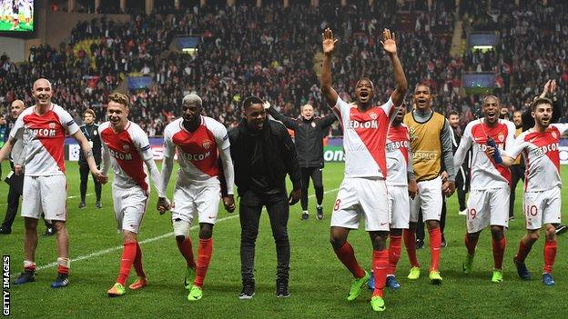 Monaco's players celebrate after overcoming Manchester City in the Champions League