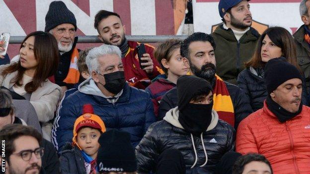 Roma fans take coronavirus precautions
