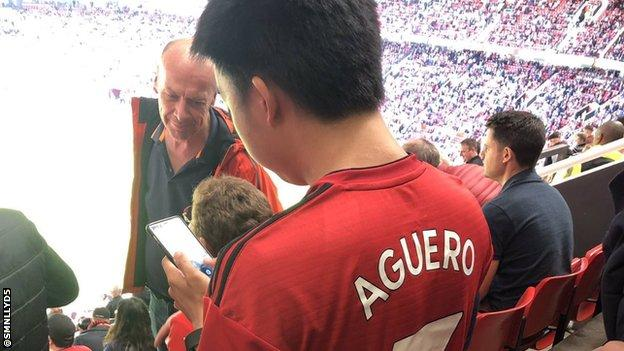 A Manchester United fan wearing an Aguero shirt at Old Trafford.