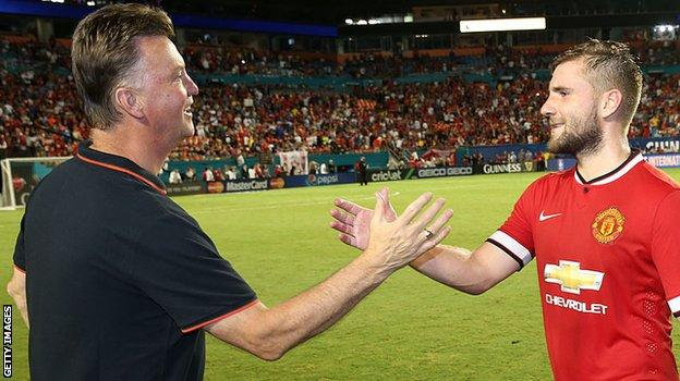 Former Manchester United manager Louis van Gaal and Luke Shaw